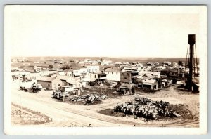 Kadoka SD~Main Street~Hotel Dakotah~Tractors & Machinery~Water Tower~1920s RPPC