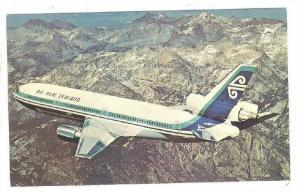 Air New Zealand s DC-10 Series 30 in flight over mountain range, 40-60s