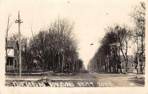 Britt Iowa~Fair Ground Boulevard~Homes Both Sides Street~Hanging Lamp~1911 RPPC
