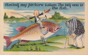 Having my picture taken, The big one is the fish, Little bald man holding fis...