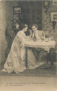 Postcard theatre man suit woman young eating table food