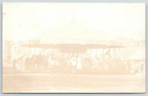 Real Photo Postcard~Carousel Set Up~Downtown~Merry Go Round~Laundry~Stores~1912