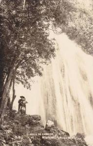 RP; Couple standing at foot of waterfall, Cola de Caballo, Monterrey, Nuevo L...