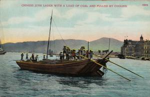 HONG KONG , China , 00-10s ; Chinese Junk laden with Coal & Pulled by Coolies