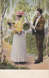 Romantic Couple Strolling With Flowers