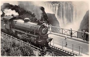 Zimbabwe, Rhodesia Railways' train crossing the Victoria Falls Bridge, Railroad