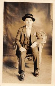 Philippines Man  Sitting in Wicker Chair Real Photo Vintage Postcard JE229712