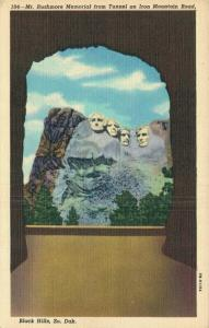 USA Mt Rushmore Memorial from Tunnel on Iron Mountain Road 01.65