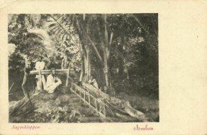 indonesia, MOLUCCAS MALUKU AMBON, Native Males Pounding Sago (1899) Postcard