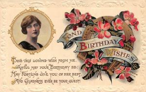 Embossed: Fond Birthday Wishes! Horseshoe, blooming flowers, beautiful woman