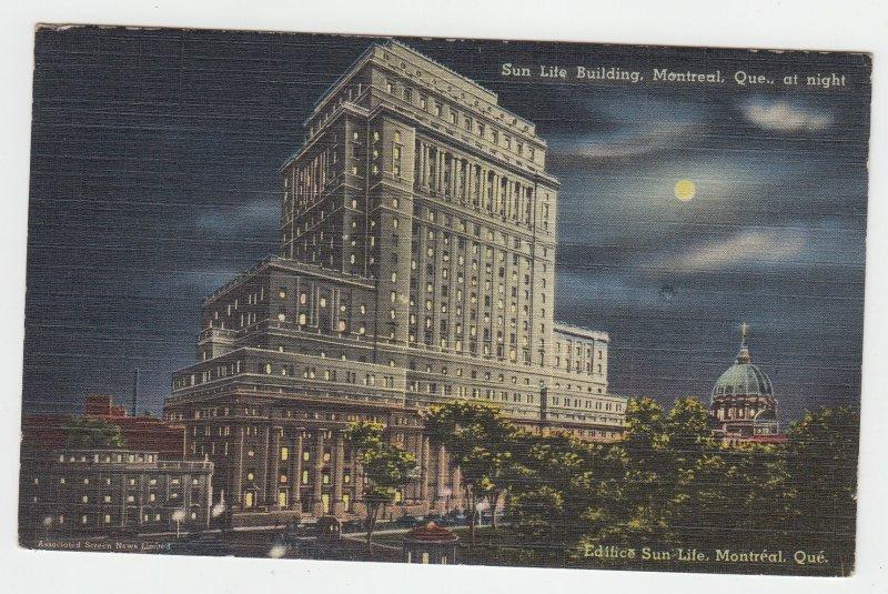 P2176 1947 postcard sun light building night full moon montreal quebec canada
