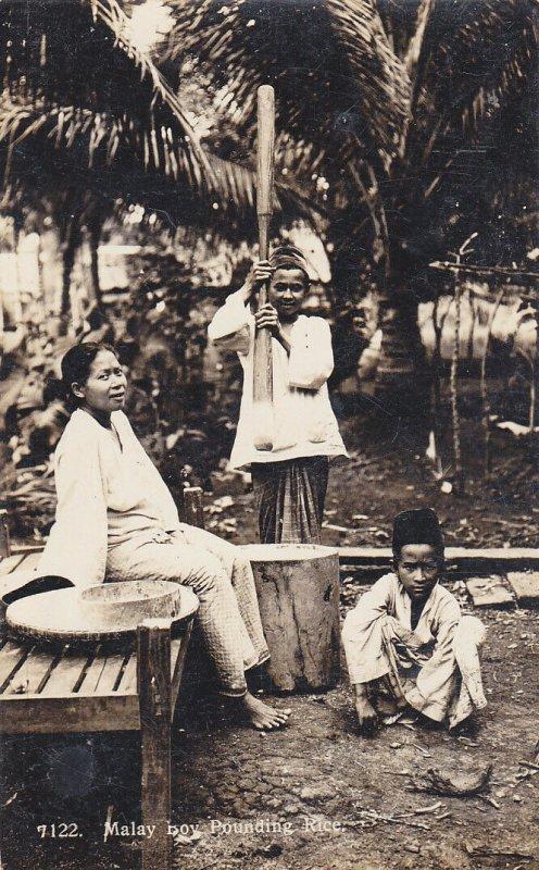 RP: Malaysia , 00-10s ; Malay boy Pounding Rice
