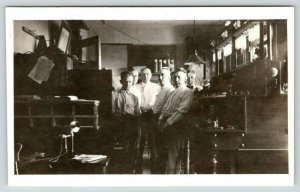 RPPC Six Men Inside Crowded Office~Coat Hooks on Wall~Candlestick Phone~c1918