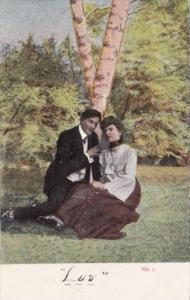 Romantic Couple Sitting Under Tree Luv