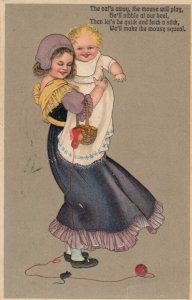 Girl holding baby away from mouse standing on red yarn, PU-1909 ; PFB 7052