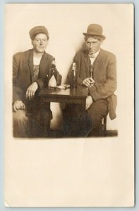 RPPC One Young Man Relaxes With a Blatz Beer Bottle~Other Has A Cigar, Too~1910