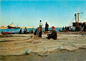 Tunisia net fishermen in the Sousse harbour