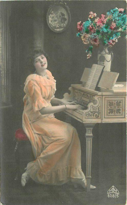 C-1910 Hand Tinted Woman playing Piano RPPC Real photo postcard 1882