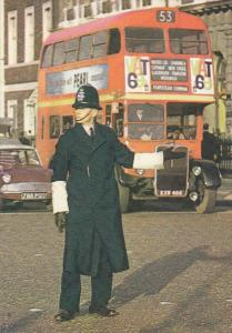 LONDON, England, 1950-1970's; London Policeman Controling Traffic, Double Dec...