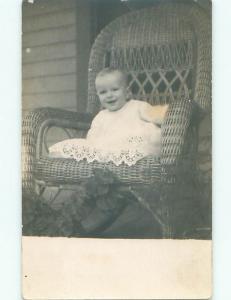 Pre-1918 rppc CUTE KID ON ANTIQUE RATTAN CHAIR o1944