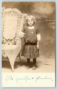 RPPC Hello, Grandpa & Grandma~Cute Girl w/Wicker Chair Bigger Than She Is~1910