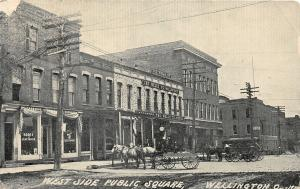 F64/ Wellington Ohio Postcard 1911 W. Side Public Square Well Millinery