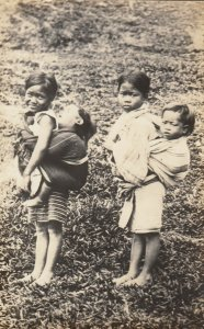 RP: PHILIPPINES , 00-10s ; Kids carrying Babies
