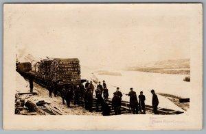 Postcard RPPC c1910s Peace River Crossing AB Men Laying Railroad Ties Geo. Cliff