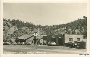 Wolf Creek MT Gas Station Cars RPPC Postcard