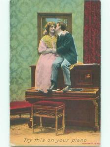 Pre-Linen ROMANTIC COUPLE SITTING ON ANTIQUE PIANO AB7521