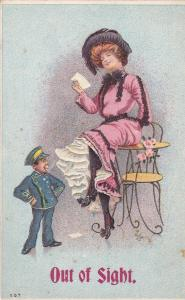 Woman sitting on table reading a letter, Man standing Out of Sight, 1900-10s