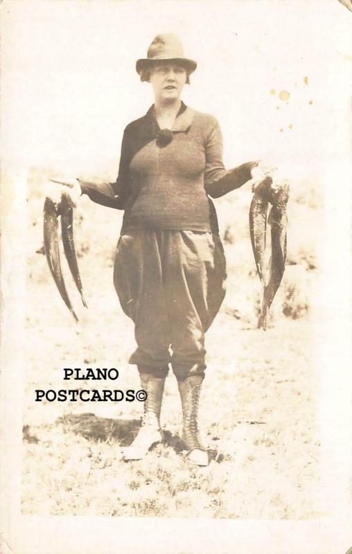 WOMAN WITH THE CATCH OF THE DAY-1920'S ERA RPPC REAL PHOTO POSTCARD