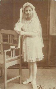 Postcard Little girl white elegant dress carrying candle