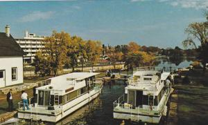 Pleasure craft cruise the picturesque Rideau Canal system, Ontario, Canada, 4...