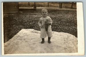 RPPC Toddler Happy to Get His Picture Taken, w/His Skinny Stuffed Animal~c1910
