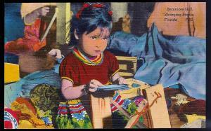 Seminole Indian Girl Stringing Beads Miami FL unused c1930's