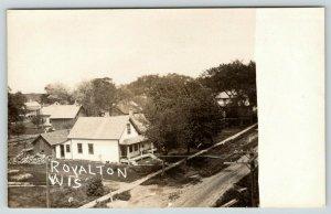 Royalton Wisconsin~Neighborhood Homes~Lumber Behind House~Barn~1908 RPPC