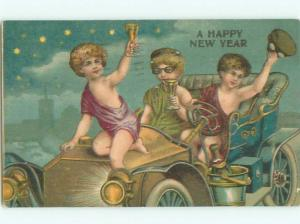 Pre-Linen New Year CUPID FIGURES IN VERY OLD CAR AB2410
