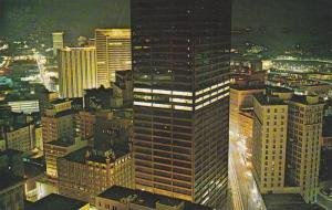 Evening view shows the Equitable Bldg.in the center,with Peachtree center,Mer...