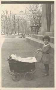 Little Girl playing with a doll pram  RPPC 03.66