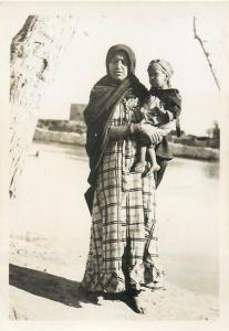 Real photo ethnic arab woman with child