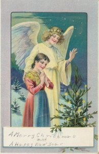 CHRISTMAS : Angel and girl looking at tree with lit candles on it, 1900-10s