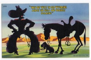030721 VINTAGE WYOMING LINEN POSTCARD COWBOY AND HORSE SILHOUETTE