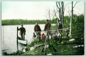 Wisconsin~Duck Hunters Pose With Strung Up Water Fowl~Rowboat~Stacked Guns~1907