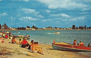 FLORIDA COAST FUN BY THE WATER~WOOD BOAT~CONFEDERTE FLAG ON BOW-1960-POSTCARD