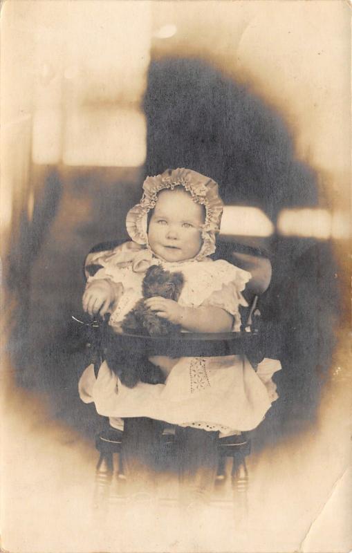 Sunbonnet Baby Girl in Highchair With Her Teddy Bear~Vignette RPPC c1910