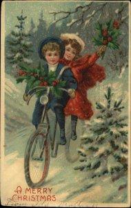 Christmas - Kids in Woods on Bicycle c1910 Postcard