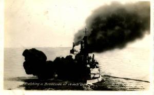 USS New Hampshire, 1916, Belching a broadside of 12-inch guns - RPPC