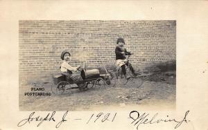 CHILDREN WITH VINTAGE TRICYCLE AND PEDAL CAR RPPC REAL PHOTO POSTCARD