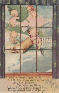 Rosie O'NEILL; CHRISTMAS ; Kewpies chopping wood , 1919